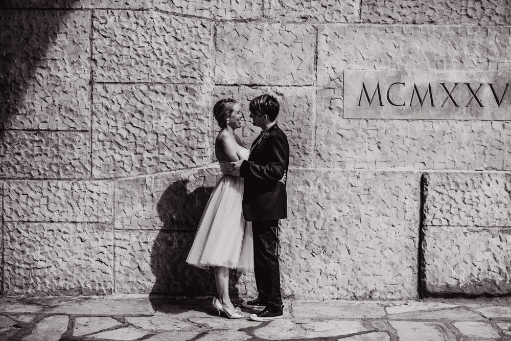 san diego wedding   photographer | women smiling staring at each other in front of wall