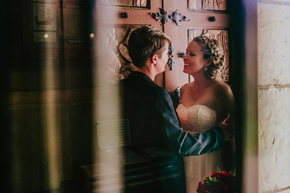 san diego wedding   photographer | women talking in front of big door