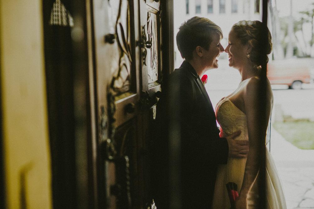 san diego wedding   photographer | woman in blazer holding woman in doorway