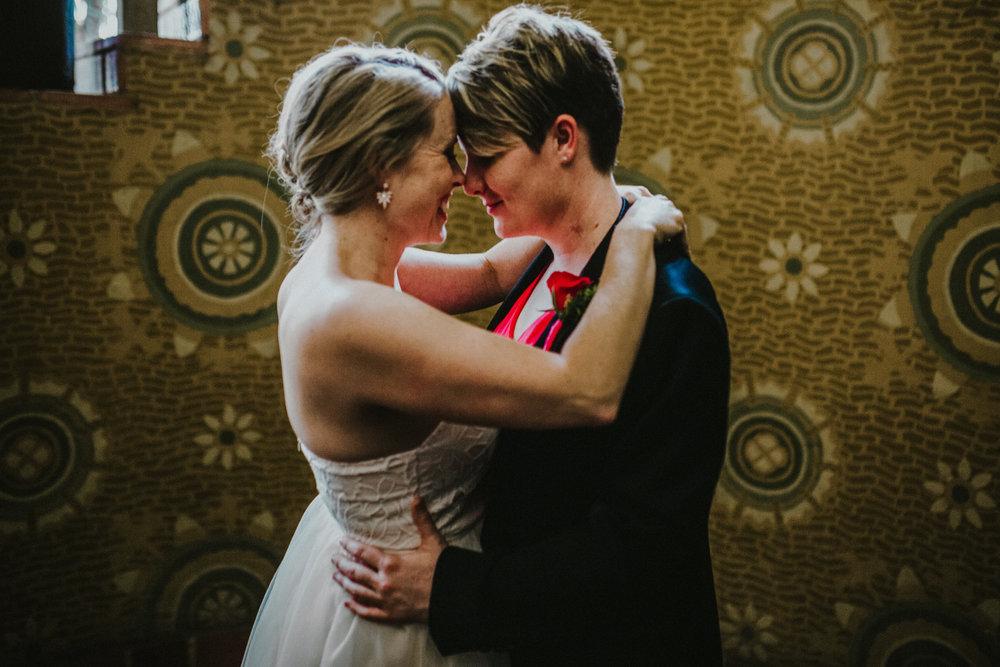san diego wedding   photographer | women touching noses near staircase