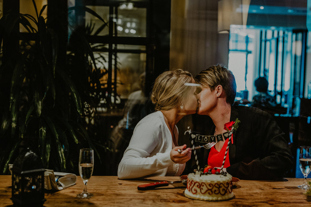 san diego wedding   photographer | women kissing with cake in front of them