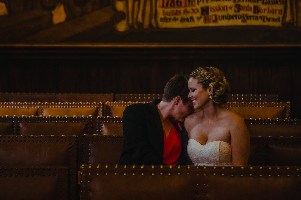 san diego wedding   photographer | woman kissing woman's shoulder while sitting