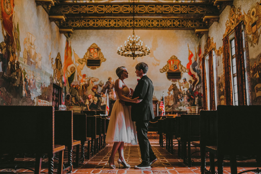 san diego wedding   photographer | women standing in each other's arms in aisle
