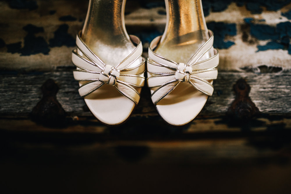 san diego wedding   photographer | tip of white heels on top of an old chest