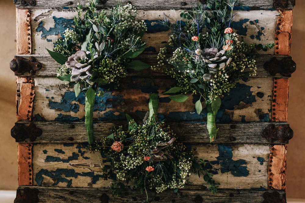 san diego wedding   photographer | 3 bouquets of flowers on an old chest
