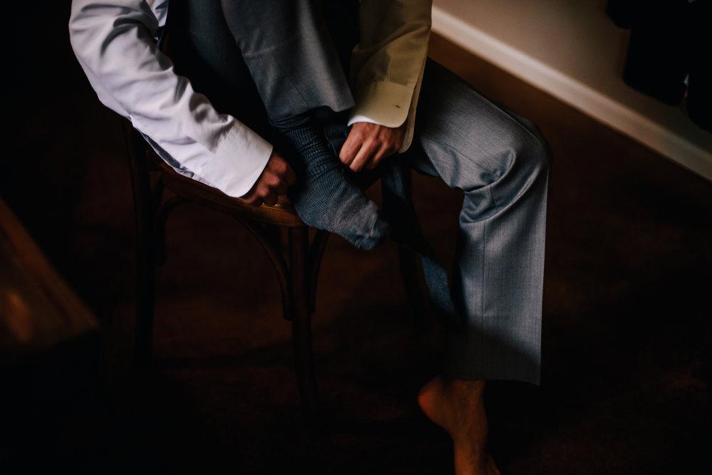 san diego wedding   photographer | man's bottom half putting on socks