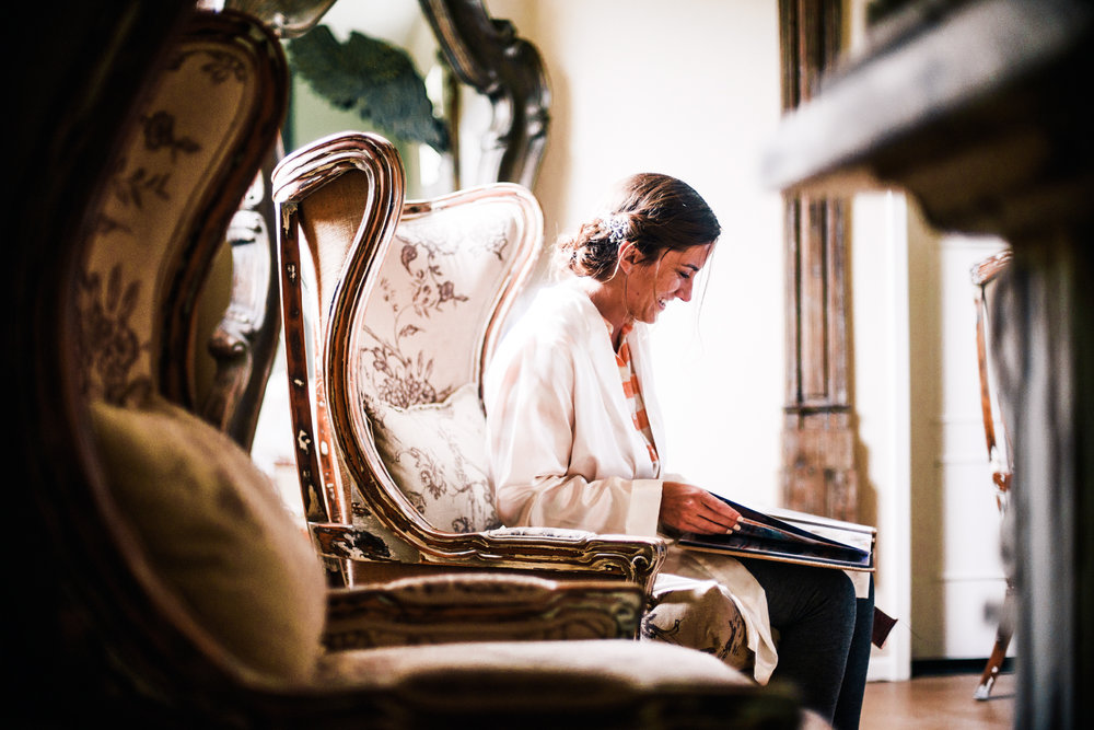 san diego wedding   photographer | woman sitting on a chair while reading a bound book