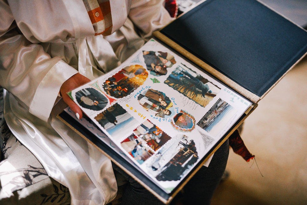 san diego wedding   photographer | woman's lap with a scrapbook on it