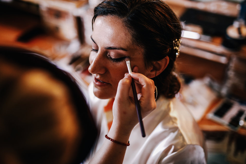 san diego wedding   photographer | woman being applied makeup to