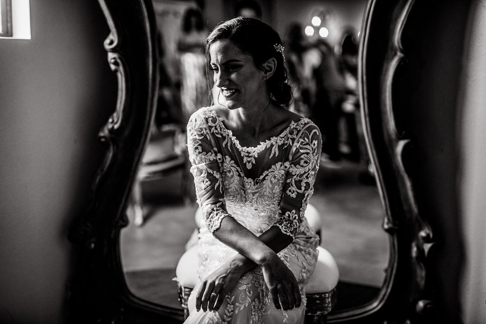san diego wedding   photographer | black and white shot of woman sitting on stool with mirror   behind her