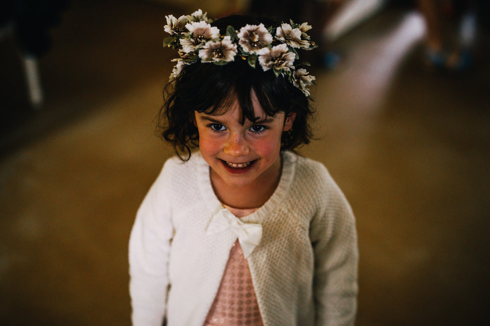 san diego wedding   photographer | child smiling with flower crown on her head