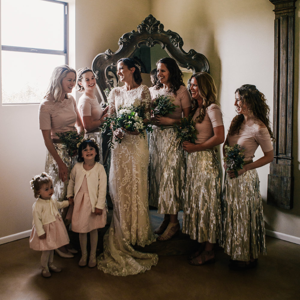 san diego wedding   photographer | group of women in dresses holding bouquets of flowers while   smiling standing in front of mirror