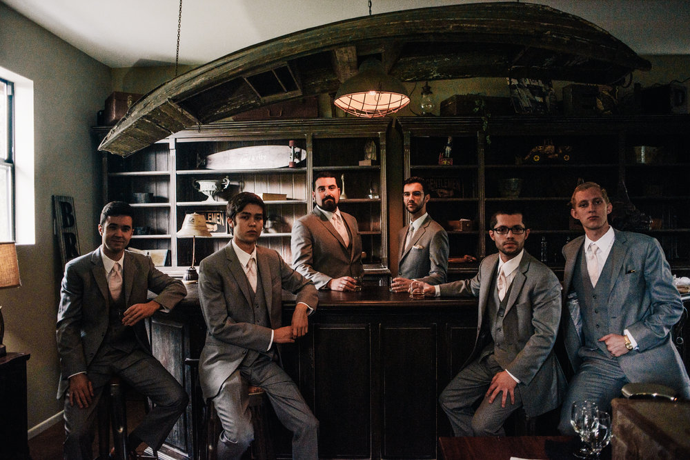 san diego wedding   photographer | group of men in grey suits at the bar looking at the camera