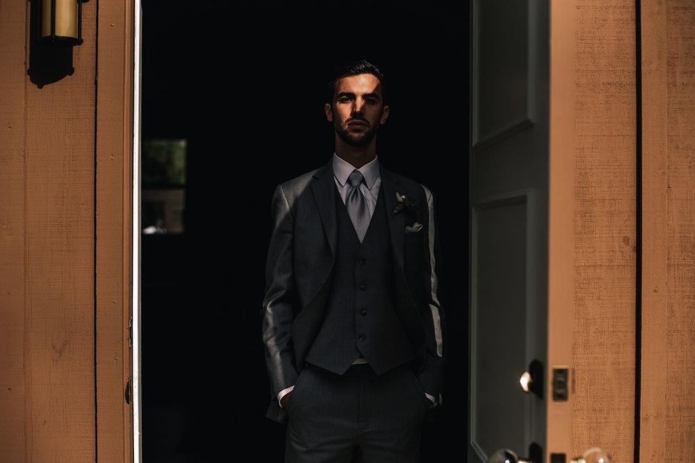 san diego wedding   photographer | man standing in the shadow of a door