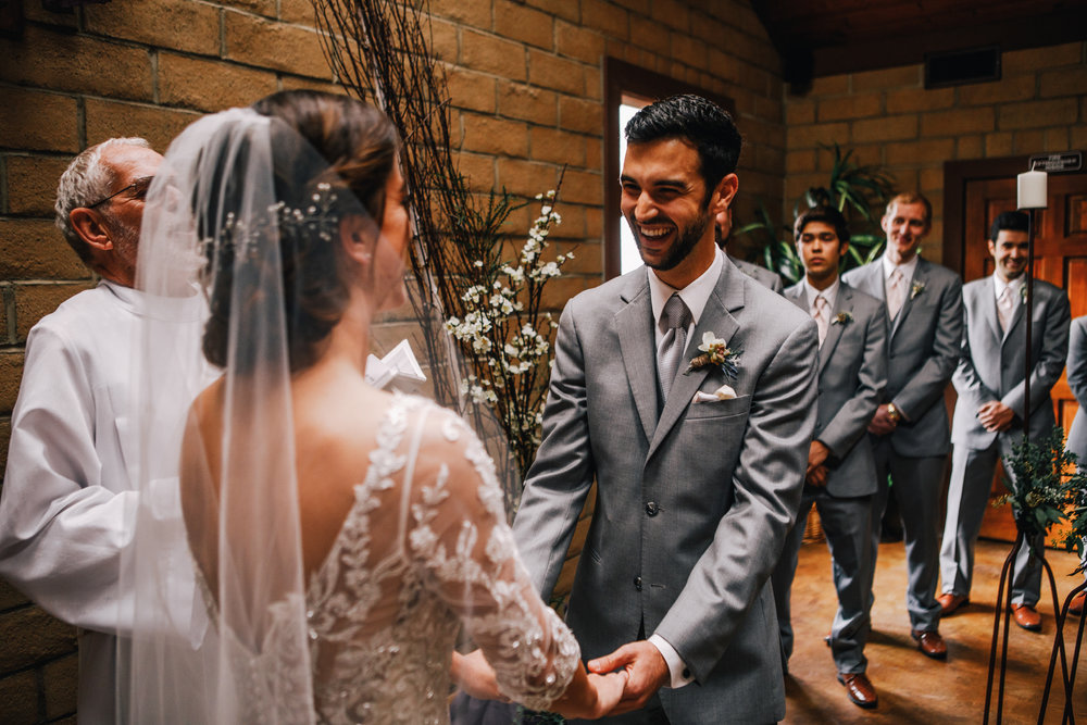 san diego wedding   photographer | bride and groom in front of wedding officiator with men in   grey suits behind groom