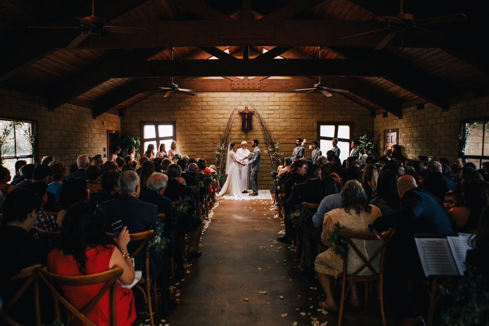san diego wedding   photographer | bride and groom holding each other's hands seen from down the   aisle
