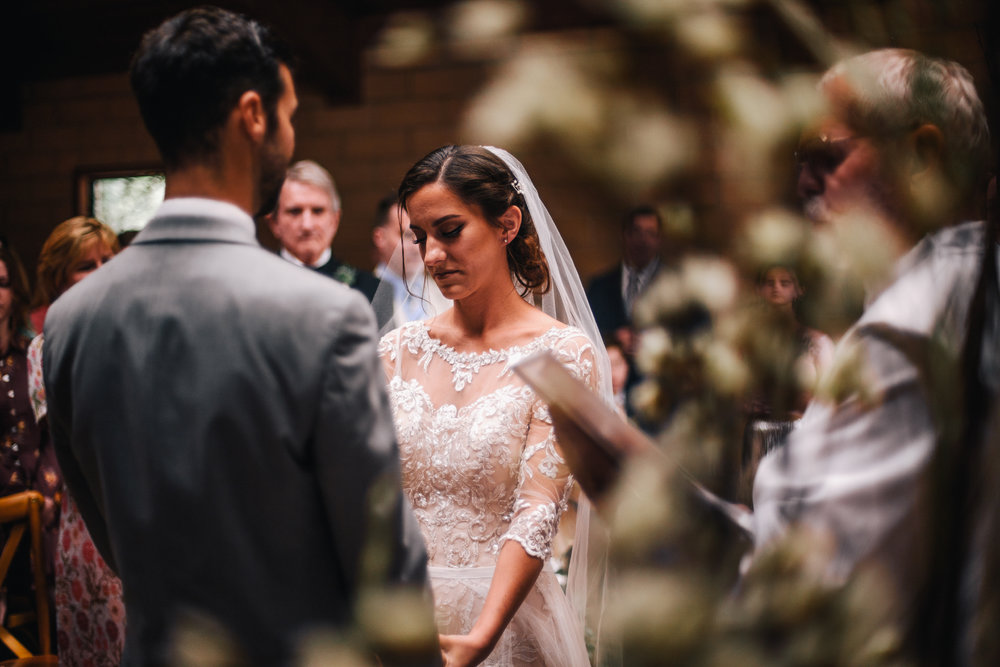 san diego wedding   photographer | bride and groom holding hands while looking down in front of   wedding officiator