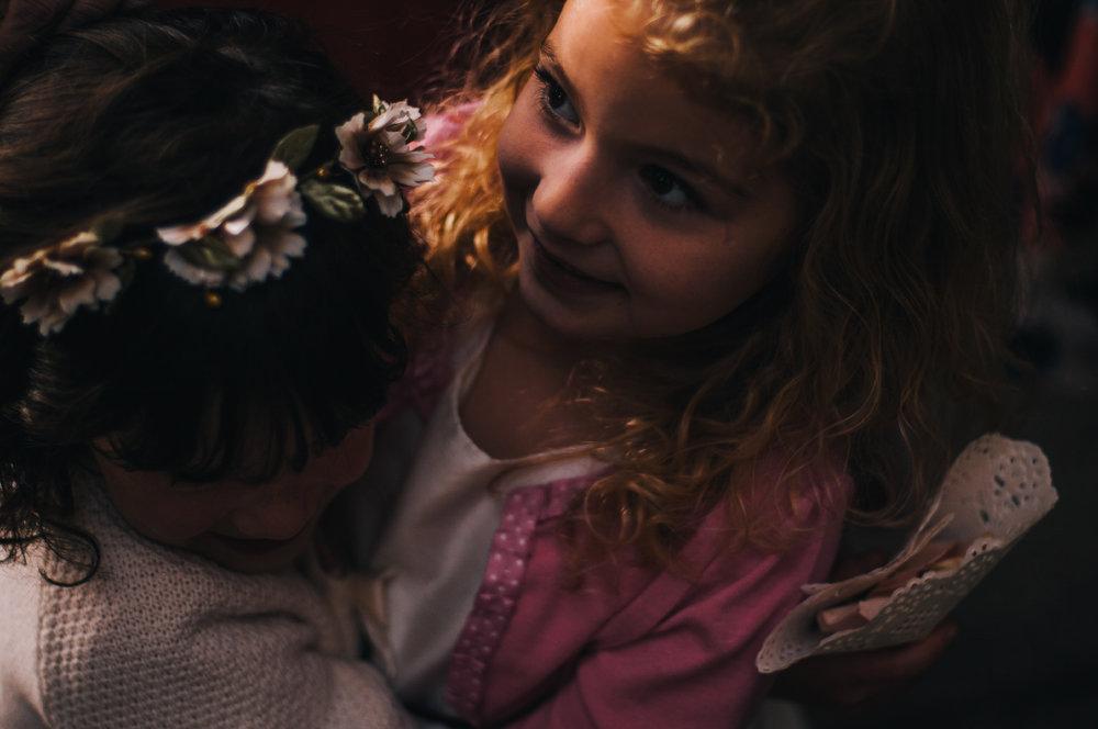 san diego wedding   photographer | child in flower crown hugging girl in pink jacket
