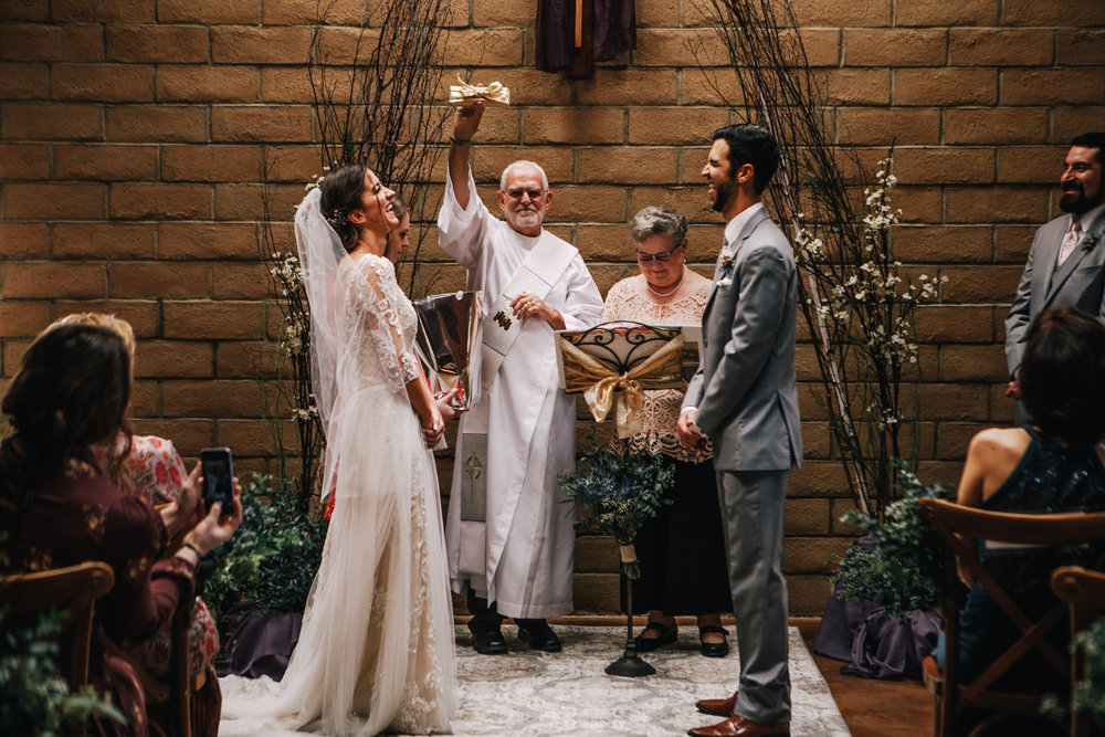 san diego wedding   photographer | bride and groom laughing with person behind lifting up pieces   of wood
