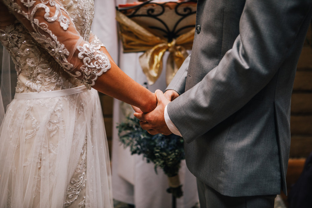 san diego wedding   photographer | lower body of bride and groom holding hands standing up in   front of officiator