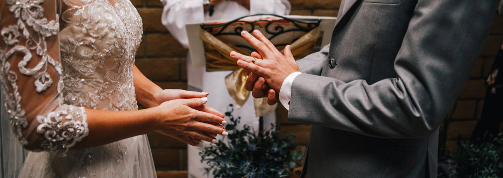 san diego wedding   photographer | torso of bride and groom with groom adjusting ring on his ring   finger