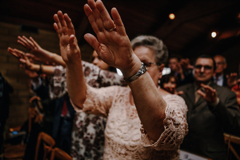 san diego wedding   photographer | old woman lifting her hands up at bride and groom