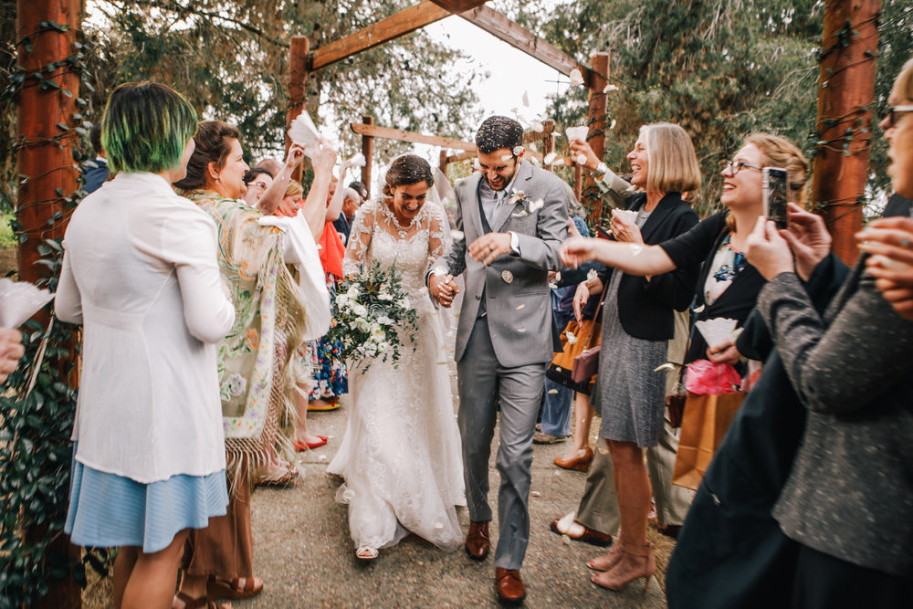 san diego wedding   photographer | married couple walking through crowds tossing rice