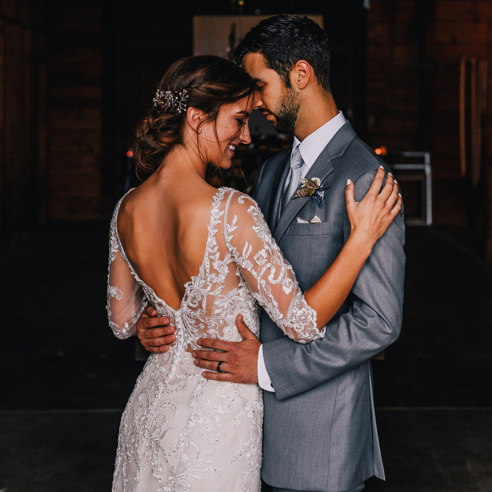 san diego wedding   photographer | view from bride's back while groom holds bride at the waist