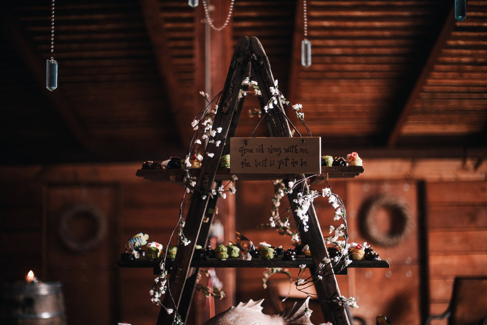 san diego wedding   photographer | step ladder with desserts and flowers on it