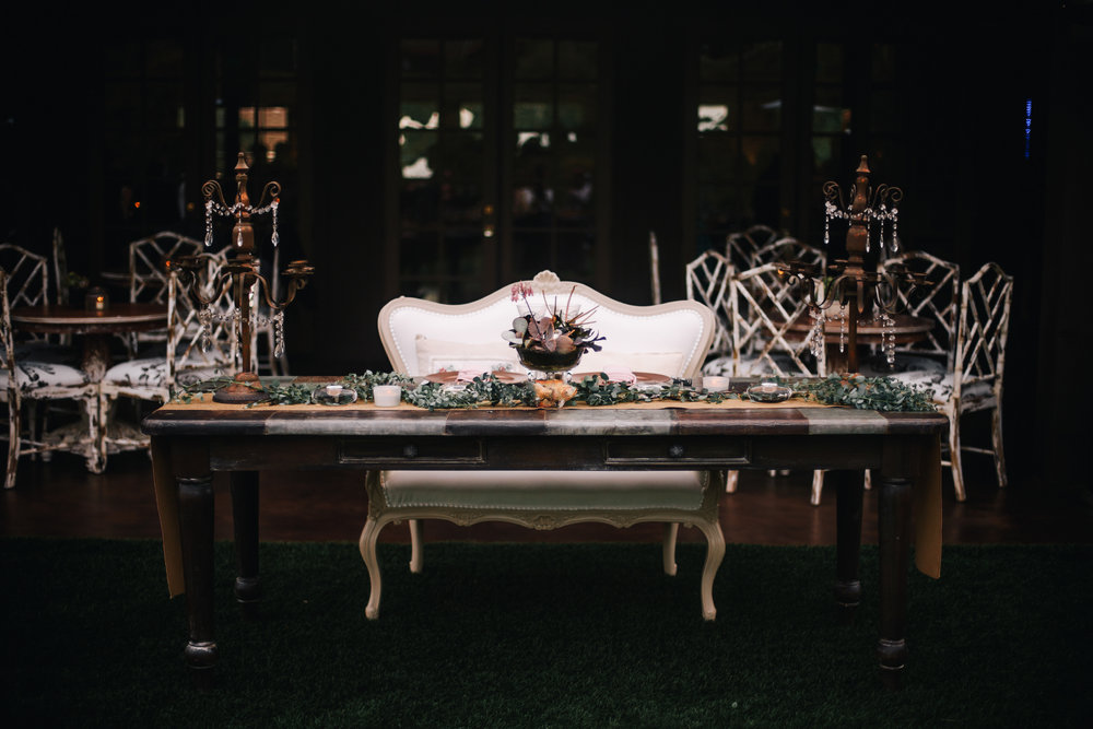 san diego wedding   photographer | white chair in front of table with assortment of arrangements   on top of it