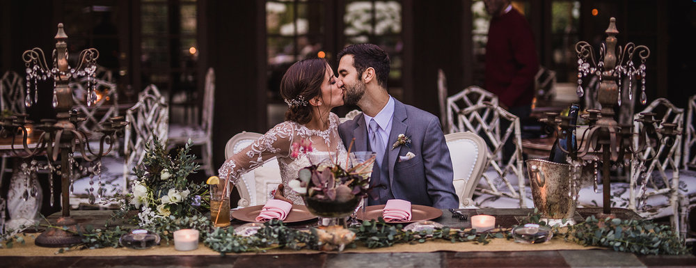san diego wedding   photographer | couple kissing in front of table arrangement with   candleholders
