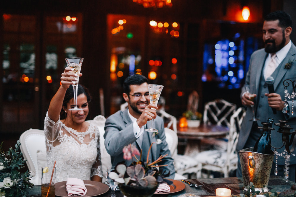 san diego wedding   photographer | bride and groom raising a glass while seated down
