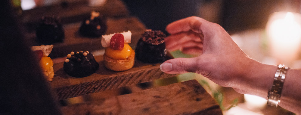 san diego wedding   photographer | woman's hand about to reach for a dessert