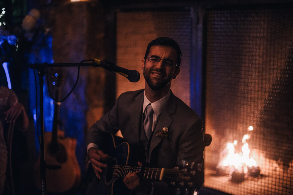 san diego wedding   photographer | groom playing a guitar while sitting down with eyes closed