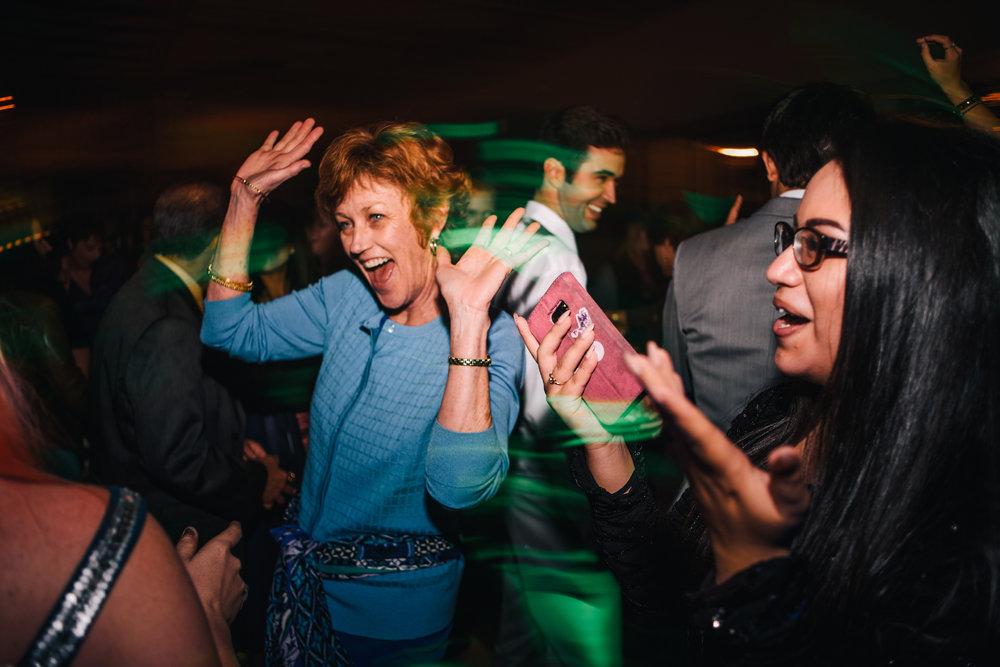 san diego wedding   photographer | long exposure shot of middle aged woman dancing on dance floor