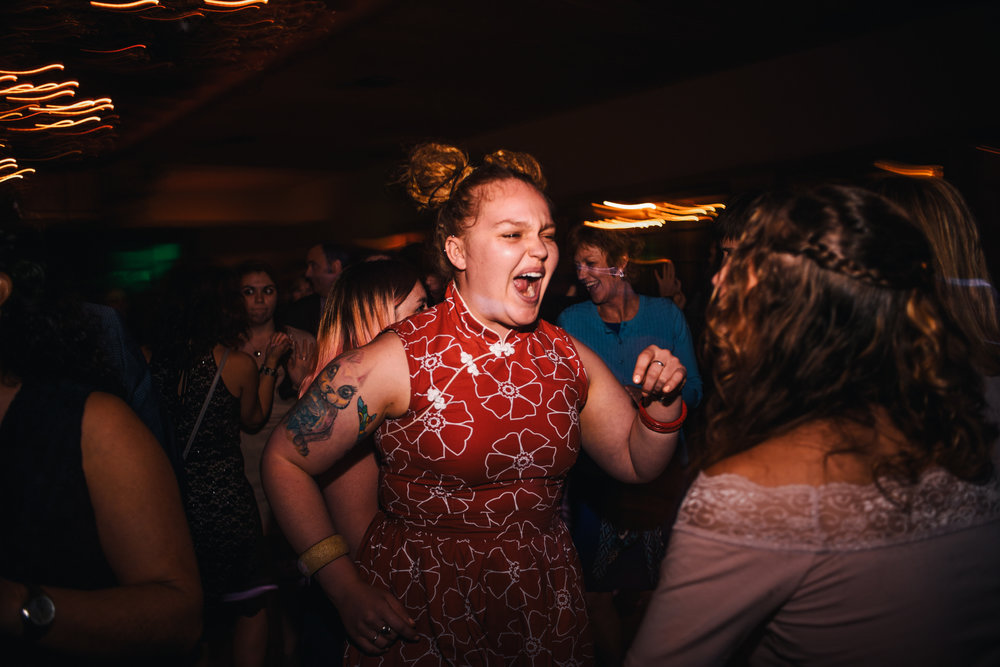 san diego wedding   photographer | woman in red dress dancing with mouth wide open