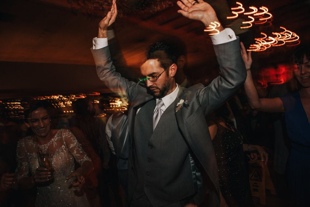 san diego wedding   photographer | groom dancing with eyes closed and arms up high