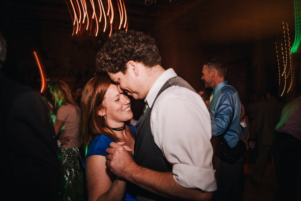 san diego wedding   photographer | man in black vest dancing with woman in blue dress