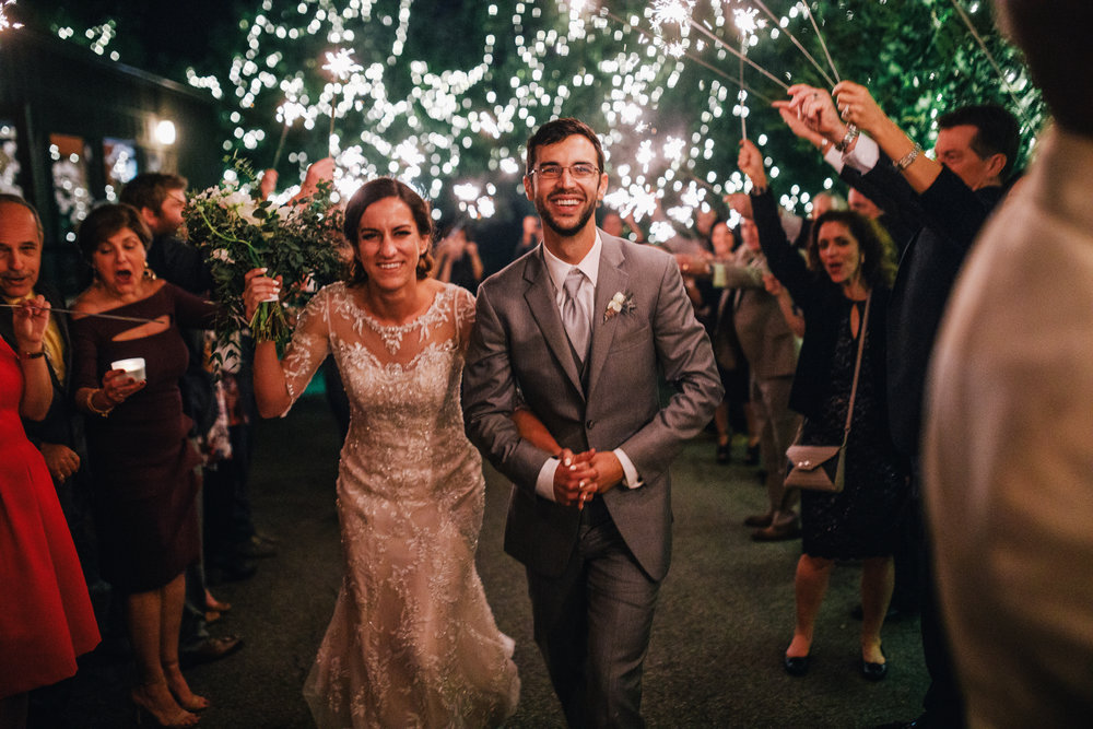 san diego wedding   photographer | newly wed couple walking under sparklers