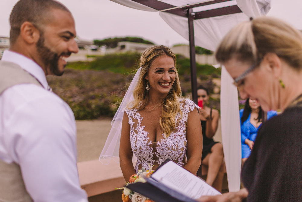 san diego wedding   photographer | married couple laughing in front of wedding officiator