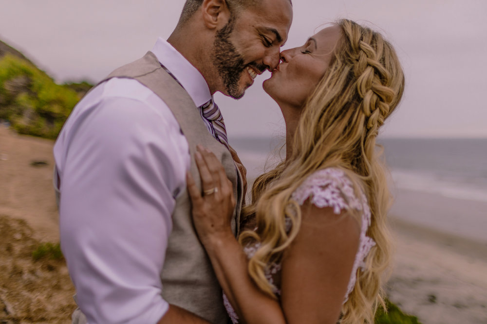 san diego wedding   photographer | woman kissing man's nose with man laughing