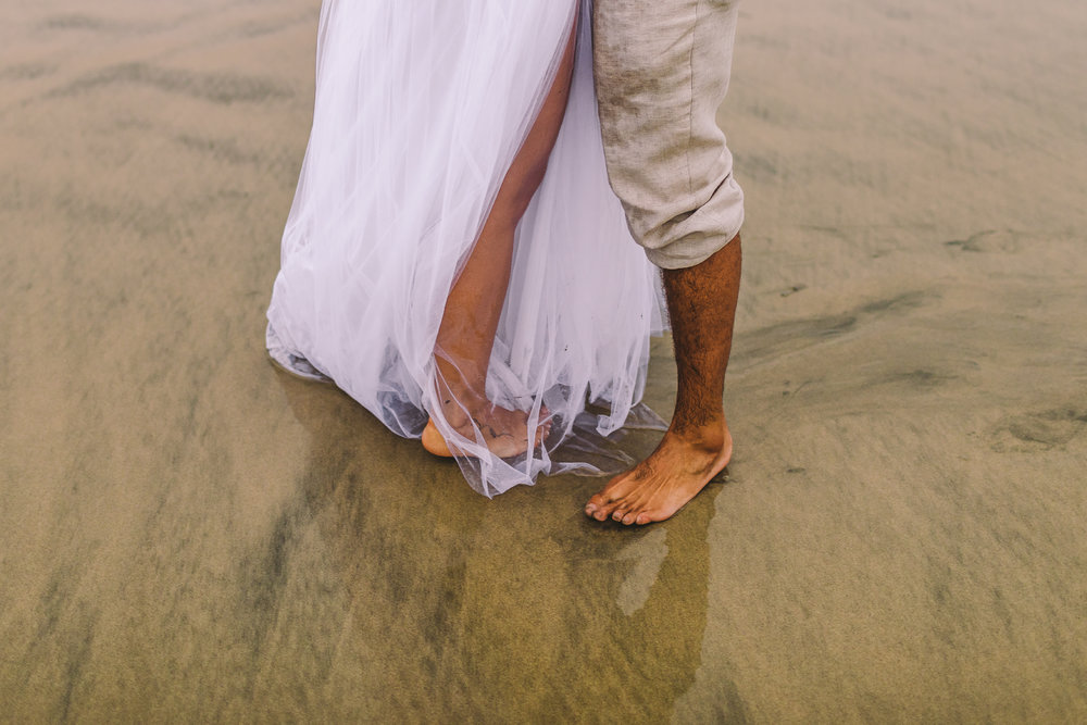 san diego wedding   photographer | picture of married couple's feet on beach shore