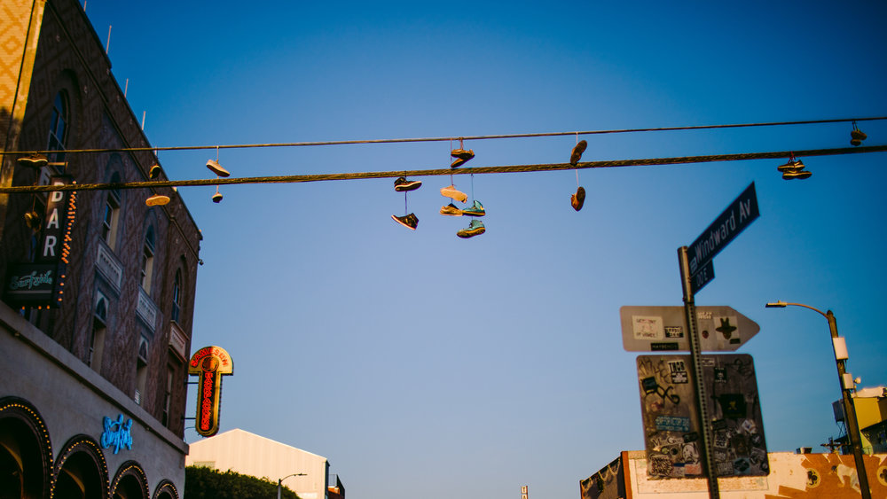 san diego wedding   photographer | power lines with shoes tied   to them against the clear blue sky