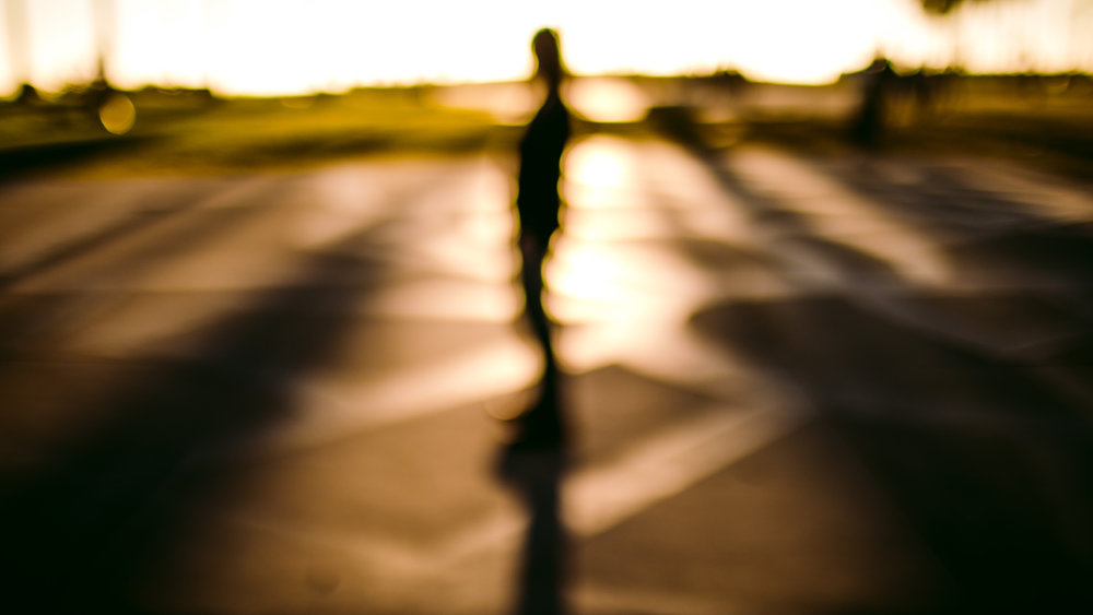san diego wedding   photographer | out of focus shot of man against sunset light