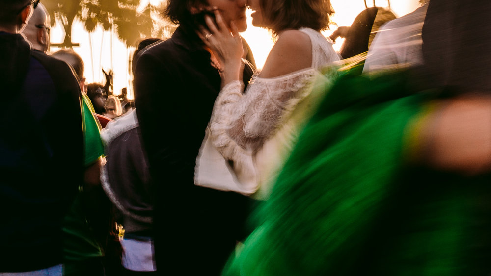san diego wedding   photographer | blurred shot of couple about to kiss in a crowded place