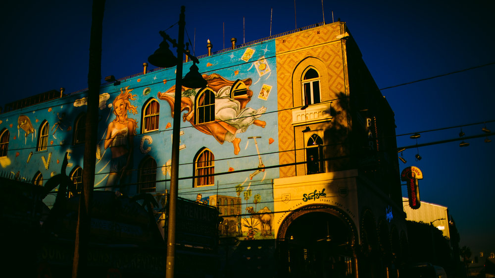 san diego wedding   photographer | shot of mural against the sunset light