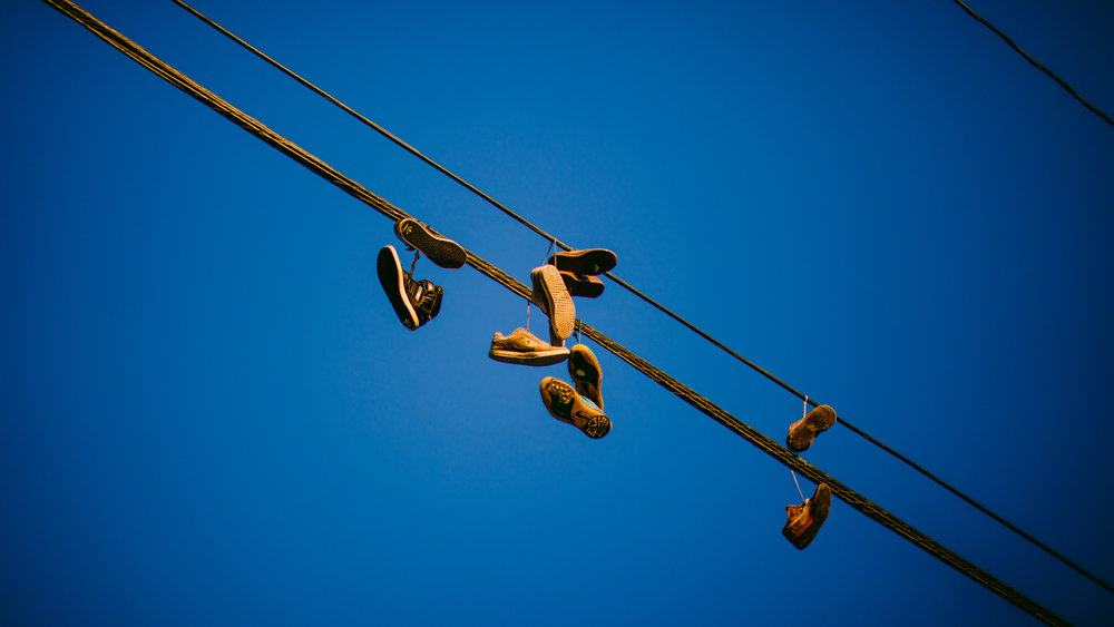 san diego wedding   photographer | powerlines with shoes stuck on them against the clear blue   sky