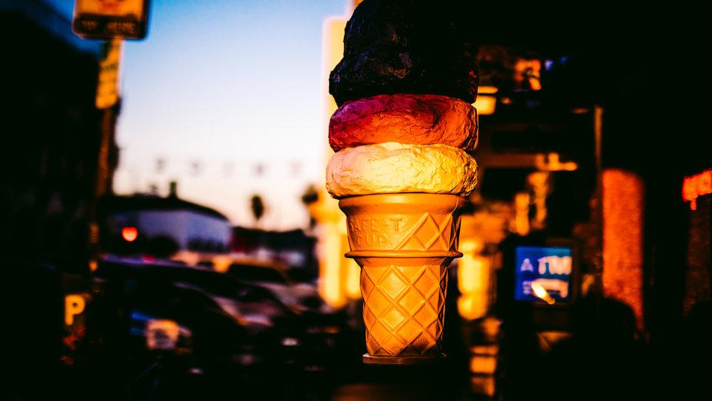 san diego wedding   photographer | statue of ice cream illuminated by sunset