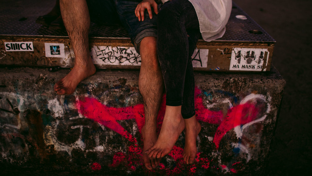san diego wedding   photographer | shot of couple's lower body sitting on concrete