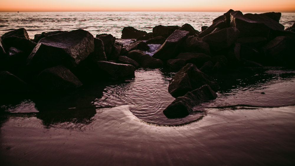 san diego wedding   photographer | picture of rocks against sunset in beach